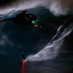 He went out surfing 40-foot waves at night (video)