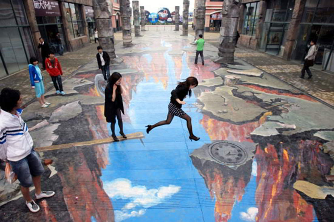 woman appears to jump across a yawning chasm in this huge piece of ...: wordlesstech.com/2011/02/26/3d-street-art