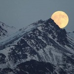 Moon rises above the Chugach Mountains