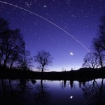 Moon, Jupiter, Discovery, and ISS are reflected in calm...