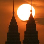 Sun sets behind the Petronas Towers