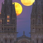 Moon rises above the cathedral
