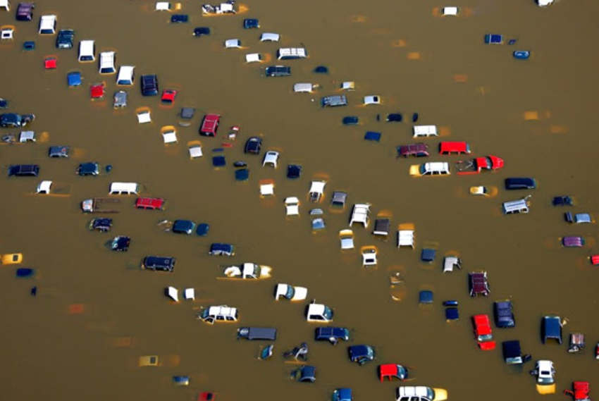 Cars in overflow water