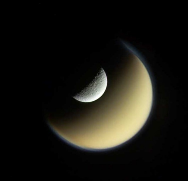 Rhea and Titan, Saturn s largest moons