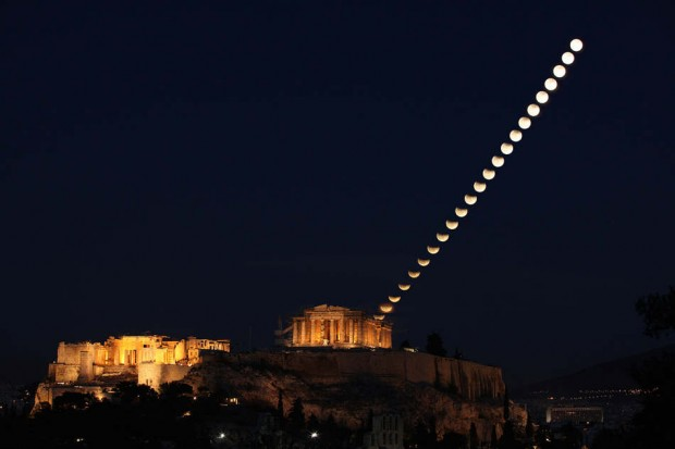 partially eclipsed Moon rising over the Parthenon