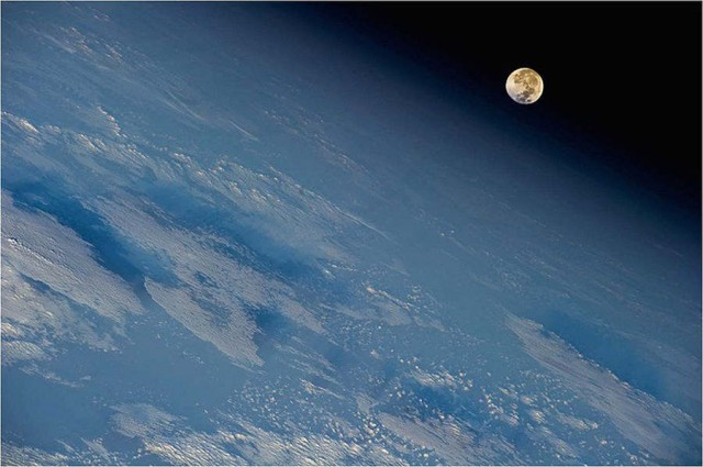 From International Space Station shows the Moon hanging over the Earth