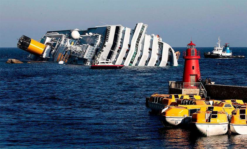 Costa Concordia leans on the rocks