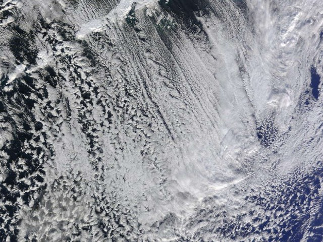 Cloud Streets across the tall volcanic peaks of the Aleutian Islands