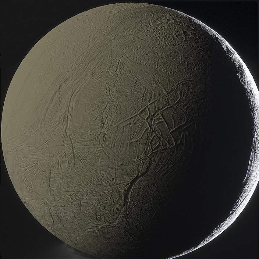 Moon Enceladus Backlit by Saturn