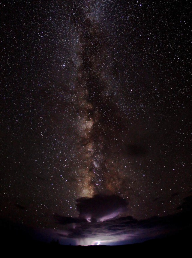 Milky Way across the desert sky and a distant monsoon thunderstorm
