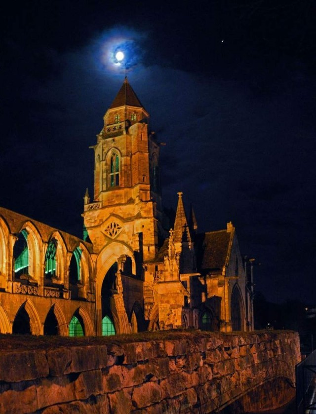 Lunar Corona, the Waxing Gibbous Moon and old church in Normandy, France
