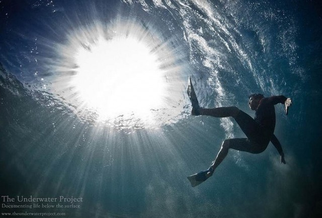 The Underwater project -Swimmers moving beneath waves