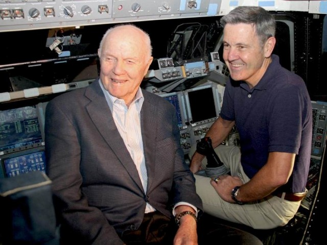 Sen. John Glenn and Kennedy Space Center Director Bob Cabana inside the flight deck of space shuttle Discovery