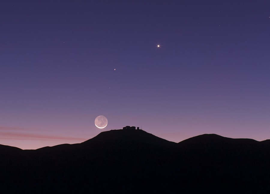the thin crescent Moon setting over ESO's Paranal Observatory in Chile