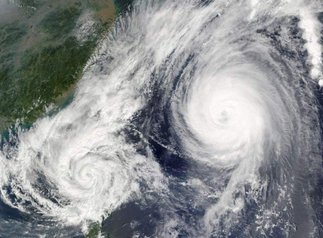 Two powerful storms in the South China Sea near the Philippines from Aqua Satellite
