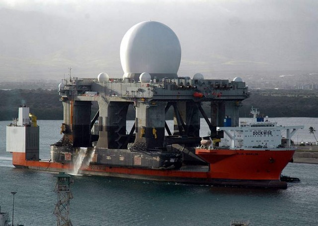 The heavy lift vessel MV Blue Marlin with its deck cargo of the Sea-Based X-Band Radar enters Pearl Harbor