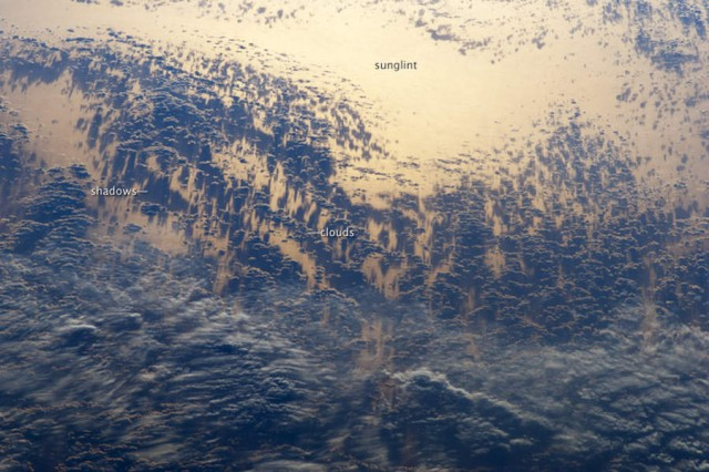 Sunglint and Clouds over the Pacific Ocean from ISS