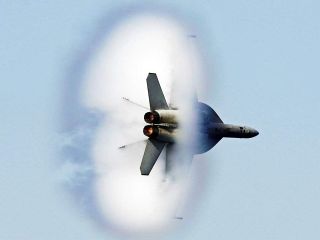 This FA-18F Super Hornet flew over visitors aboard the USS Kitty Hawk and stunned everyone with a supersonic demo