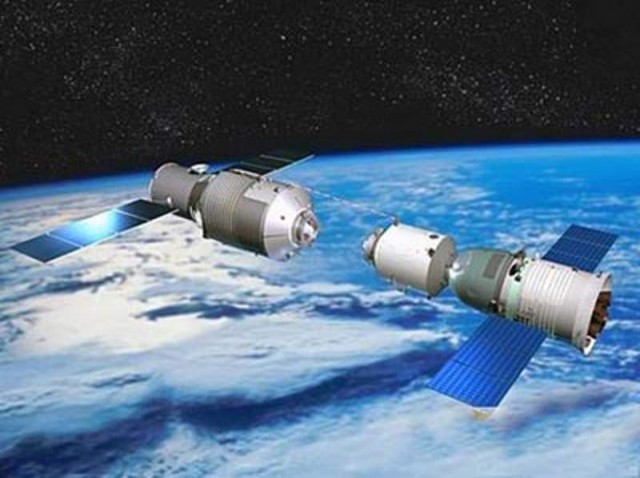 Tiangong-1 module, China's space station and to the right is a Shenzhou spacecraft
