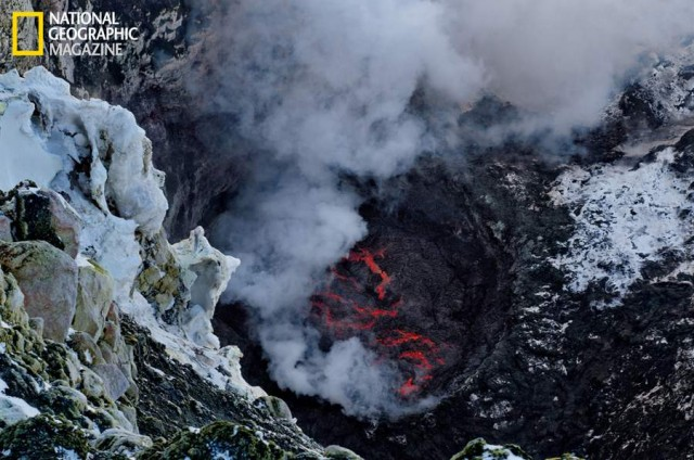 Ice and snow in the foreground, the lava lake of Mount Erebus below