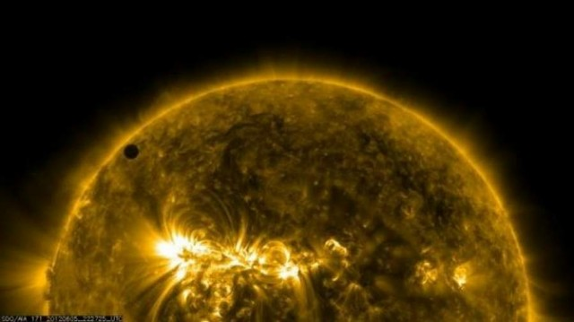 Solar Dynamics Observatory image of the Venus transit with stunning coronal loops