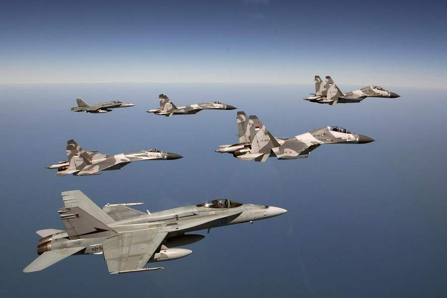 Formation of 4 Sukhoi flanked by 2 FA-18A