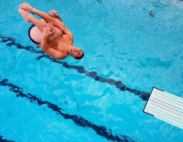 A reverse from a 3 meter springboard in the tuck position