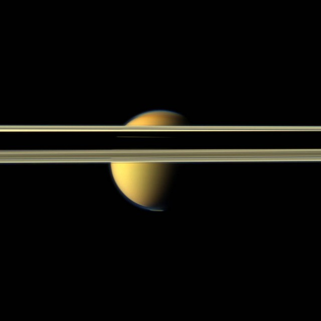 Titan obscured by Saturn Rings