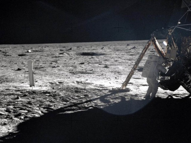Neil Armstrong standing on the surface of the moon and Apollo 11