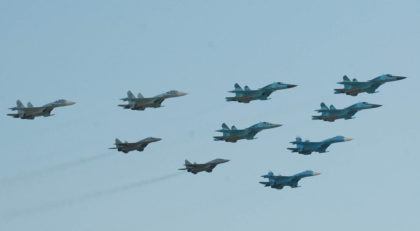 Four Su-34s, four Su-27Ms and two MiG-29SMTs flying together