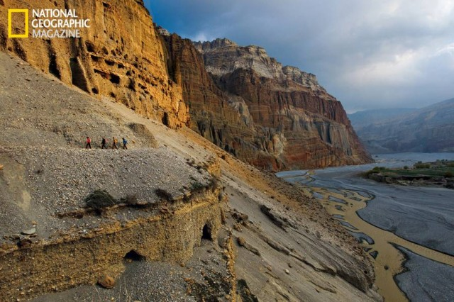 Climbers and scientists follow a trail above the Kali Gandaki River in Nepal