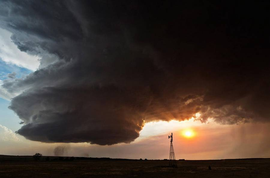 A large storm cloud twists above wheat fields in Western Nebraska