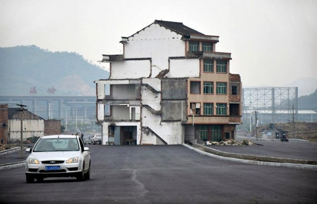 A house sits in the middle of a new Highway