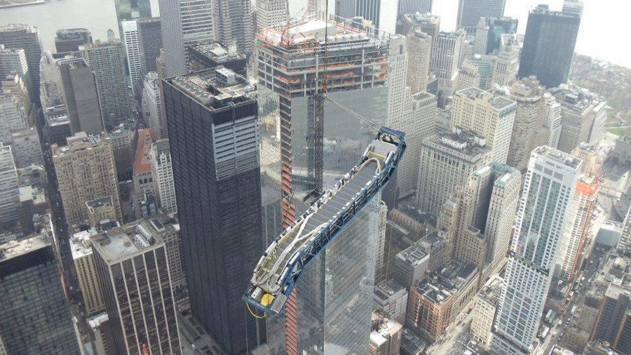 An escalator suspended above Southern Manhattan