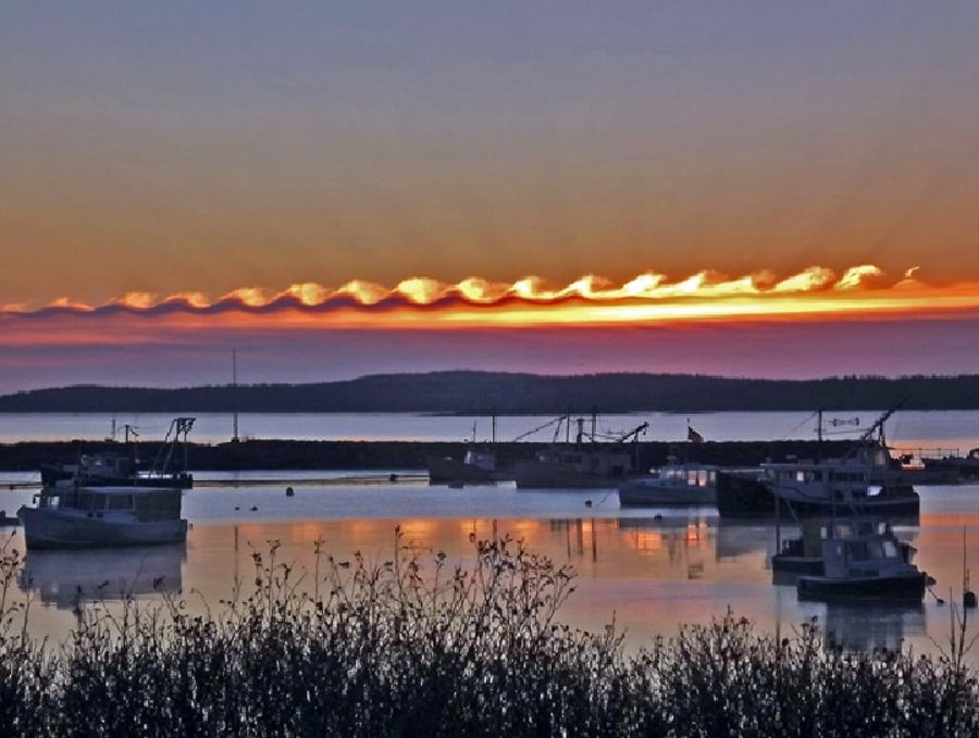 Beautiful wave-like Kelvin-Helmholtz clouds