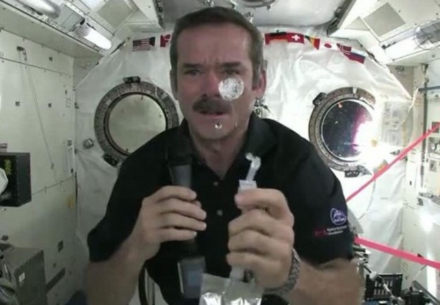 See Chris wash his hands in Space