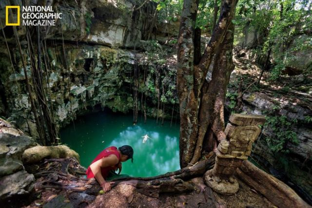 Boys from the village of Yaxuná cool off in a cenote