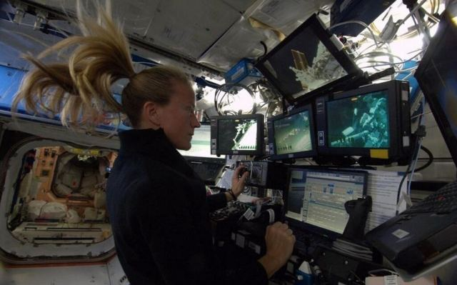 Astronaut Nyberg controlling the robotic arm
