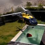 Helicopter steals pool water to fight fire