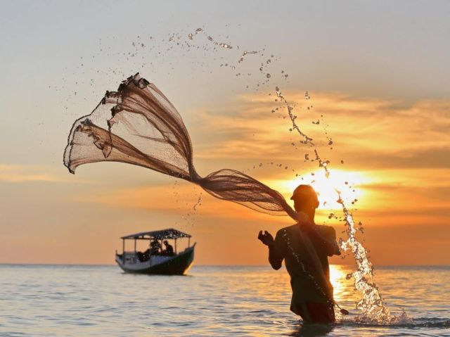 Another Perspective of the Day, The fisherman at Bira Beach. National Geographic / Dody Kusuma