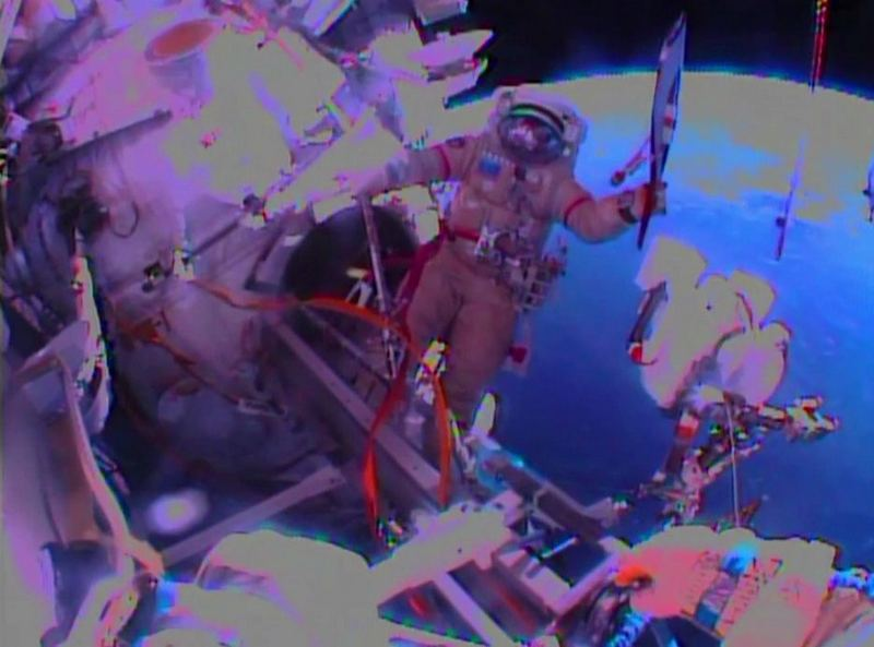 Spacewalk with Olympic Torch