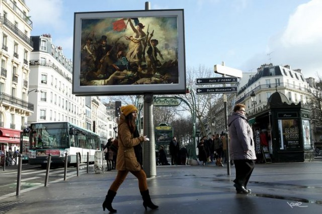 Artist replaces Billboard Commercials with Art in Paris 1