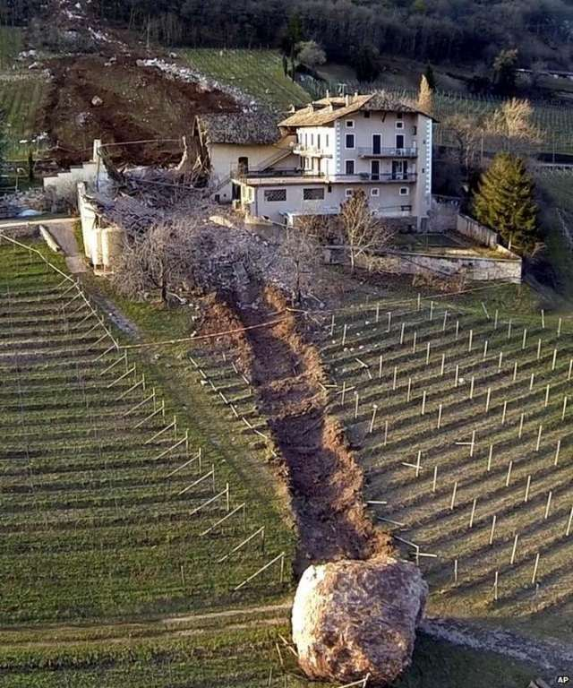 Giant rock smashes through Italian farm 1