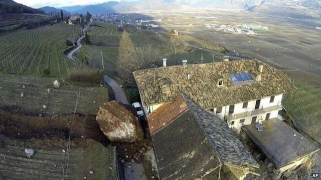 Giant rock smashes through Italian farm (2)