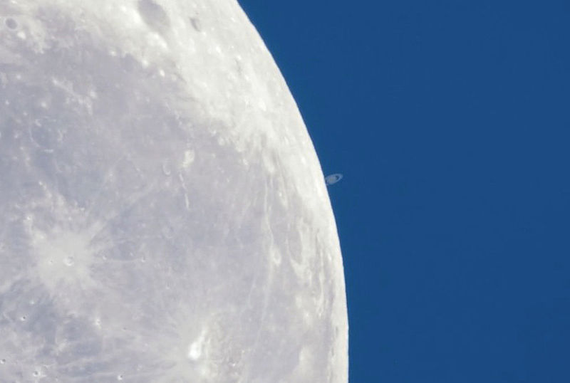 Moon passes in front of Saturn