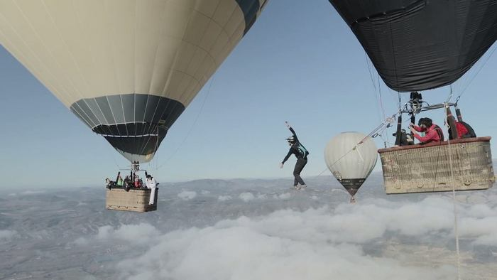 Tightrope Walking between two Air Balloons 2