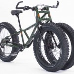 Three-wheeled bike floats over Sand and Snow