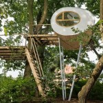 Rounded shape treehouse by Baumraum