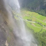 Wingsuit flying through a Waterfall