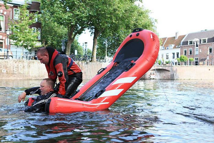 Rescue Tip-Board inflatable life-raft
